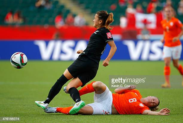 Sherida Spitse of Netherlands makes a play on the ball against Ali Riley of New Zealand during the FIFA Women's World Cup Canada 2015 Group A match...