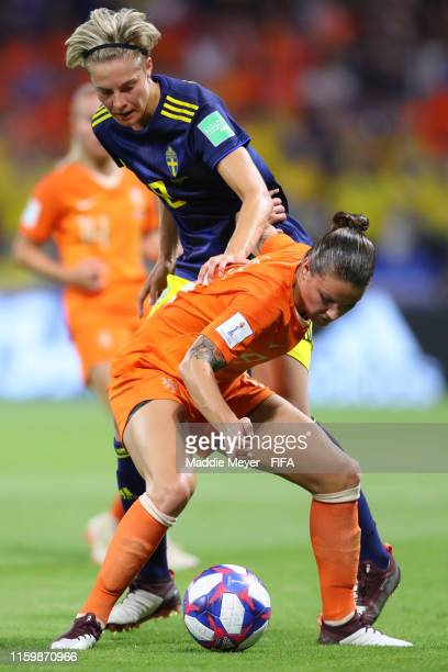 Sherida Spitse of the Netherlands is put under pressure by Lina Hurtig of Sweden during the 2019 FIFA Women's World Cup France Semi Final match...