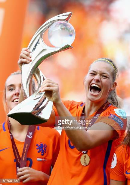 Sherida Spitse of the Netherlands lifts the trophy following the Final of the UEFA Women's Euro 2017 between Netherlands v Denmark at FC Twente...