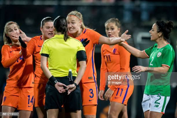 Sherida Spitse of the Netherlands referee Anastasia Pustovoitova Stefanie van der Gragt of the Netherlands Lieke Martens of The Netherlands Sophie...