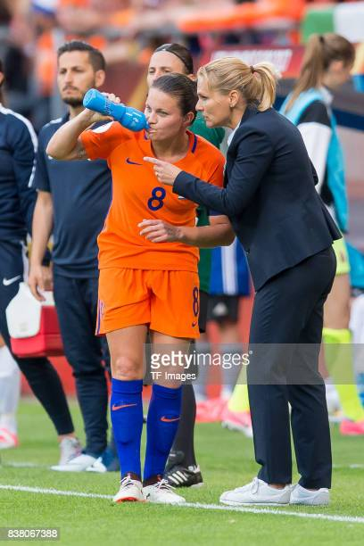 Sherida Spitse of the Netherlands speak with Head coach Sarina Wiegman of the Netherlands during their Group A match between Netherlands and Norway...