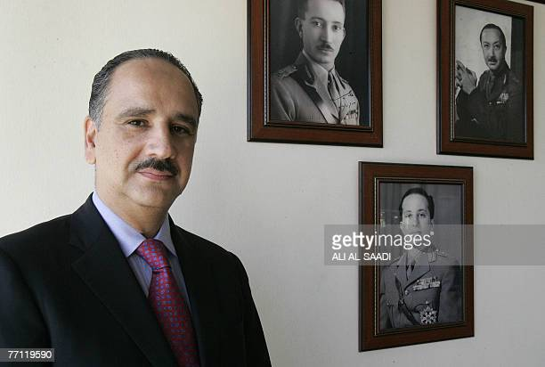 Sherif Ali bin Hussein greatnephew of Iraq's King Faisal I poses for a photograph at his house in Baghdad during an interview with AFP 29 September...