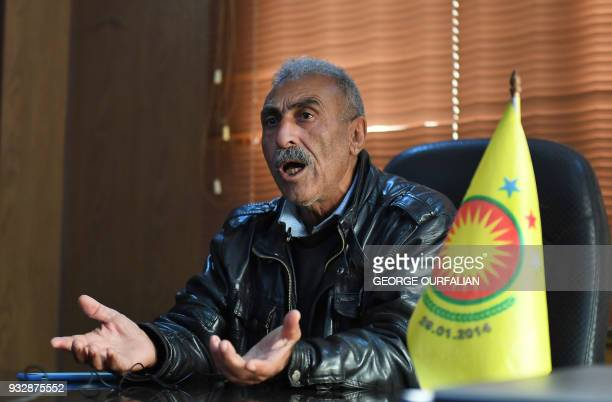 Sherif Jamou the deputy chairman of the local council of the northern Syrian border enclave of Afrin speaks to AFP during an interview in his office...