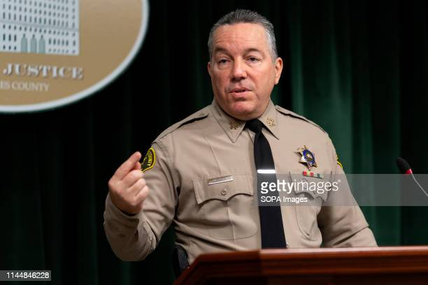 Sheriff Alex Villanueva seen speaking to the media during a press conference in Los Angeles.