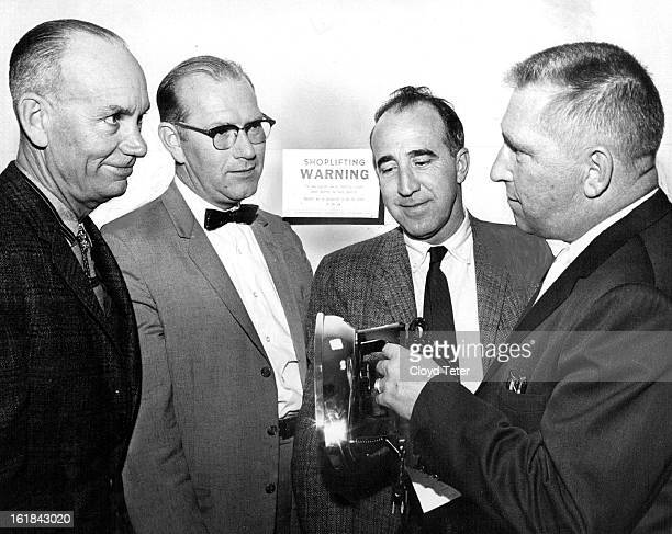 DEC 6 1961 DEC 7 1961 Sheriff Art Wermuth Right Shows Officials the iron he 'Shoplifted' Examining the evidence are from left Commissioner Chet...