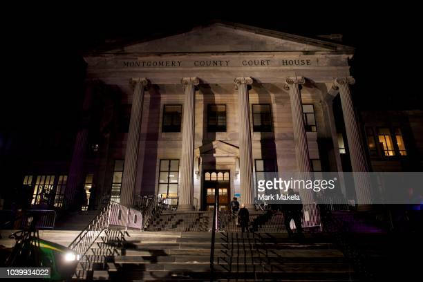 Sheriff ascends the front steps pre-dawn outside the Montgomery County Courthouse before Bill Cosby's arrival on the second day of sentencing in his...