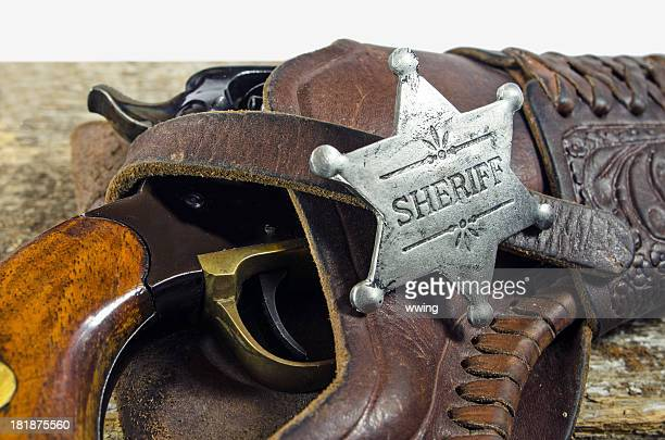 Sheriff Badge and Revolver on Barn Board
