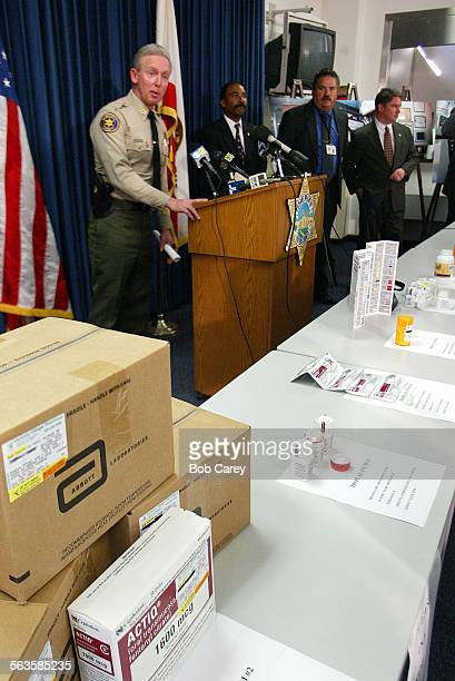 Sheriff Bob Brooks left holds a press conference to announce the arrest of Dr Michael Huff and druggist Richard Ozar on 90 counts involving...