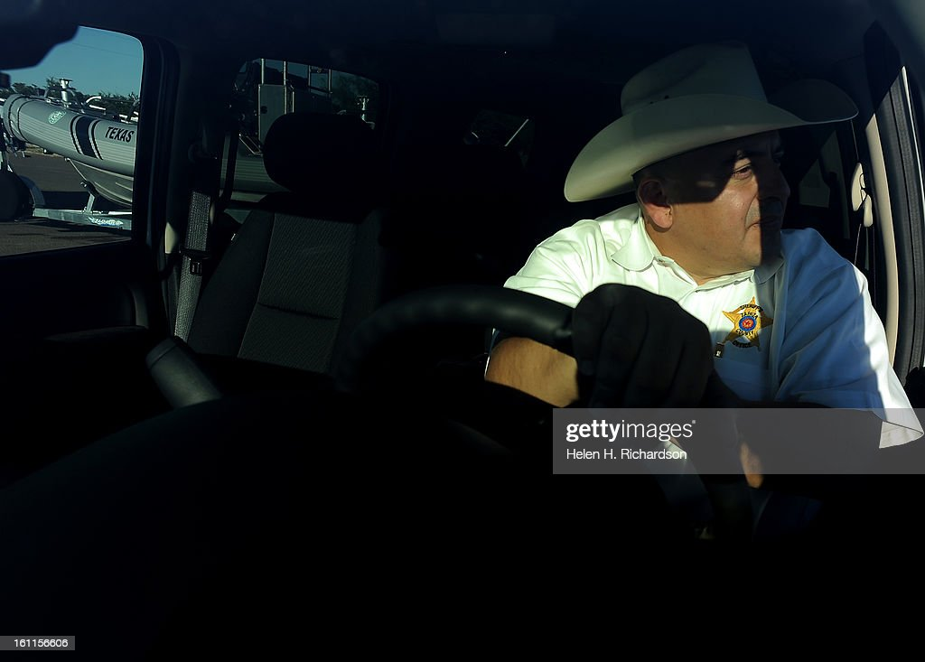 Sheriff Captain Aaron Sanchez Sits In His Patrol Car While Texas Game Wardens Put Boats Into The Water For Daily Patrols On