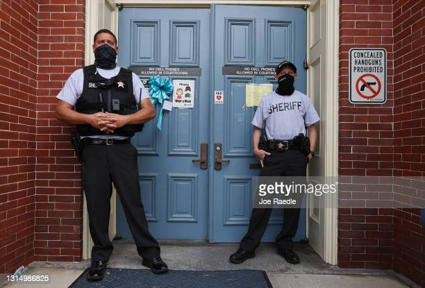Sheriff Deputies stand in front of the front entrance to the Pasquotank County Courthouse on April 28, 2021 in Elizabeth City, North Carolina....