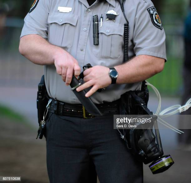 A sheriff deputy holds the knife ceased by a demonstrators against the removal of a Confederate statue coined Silent Sam on the campus of the...