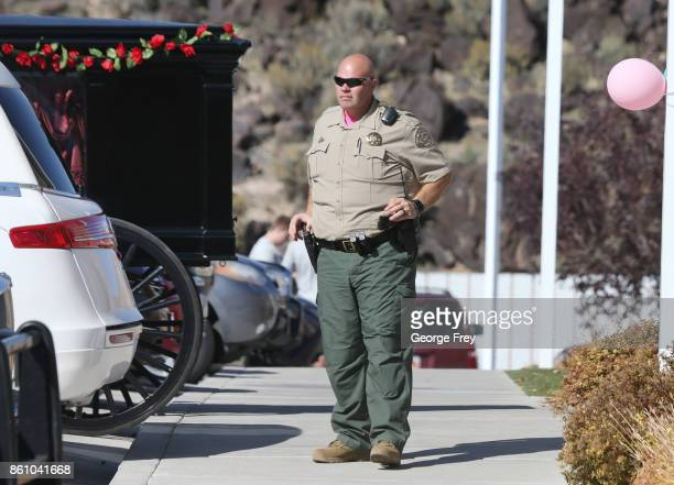 A sheriff deputy provides security outside the chapel of the Church of Jesus Christ of LatterDay Saints during the funeral of Heather Lorraine...