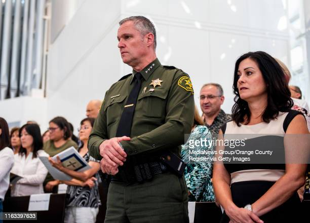 Sheriff Don Barnes, center, and his wife, Marilyn Barnes, right, attend the Solemn Evening of Prayer in Thanksgiving ceremony at Christ Cathedral in...