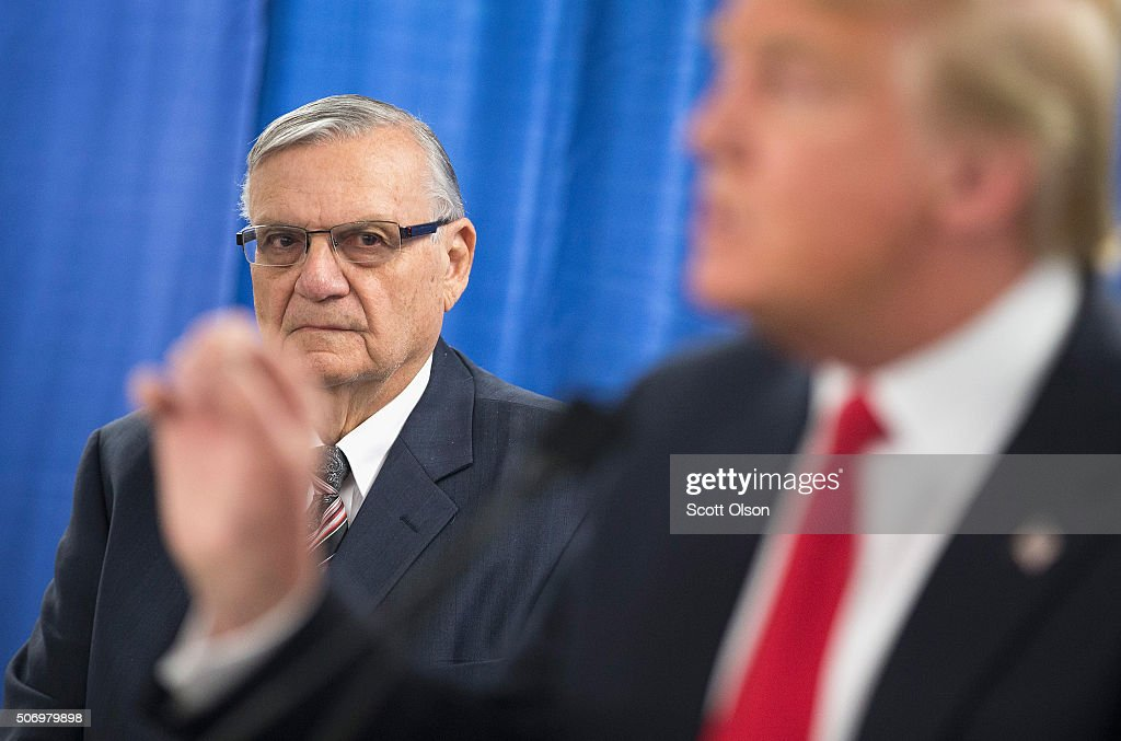Sheriff Joe Arpaio (L) of Maricopa County, Arizona listens as Republican presidential candidate Donald Trump speaks to the press prior to a rally on January 26, 2016 in Marshalltown, Iowa. Arpaio today announced his support for Trump's presidential bid.
