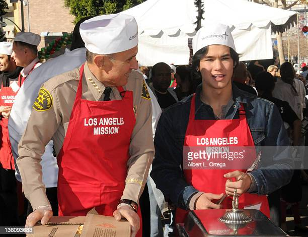 Sheriff Lee Baca and actor Booboo Stewart participate in The Los Angeles Mission Christmas Event For The Homeless held at L.A. Mission on December...