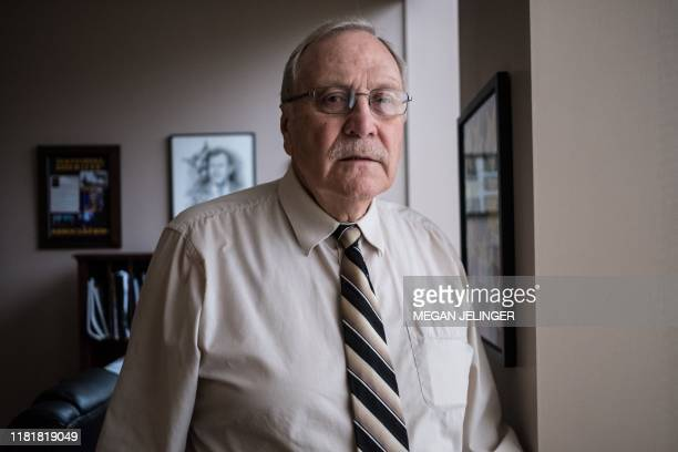 Sheriff Lenhart of Shelby County who helped facilitate the armed teachers training in Sidney City Schools poses in his office in Sidney Ohio October...