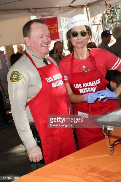 Sheriff of the County of Los Angeles in California Jim McDonnell and Minnie Driver are seen at the Los Angeles Mission Thanksgiving Meal for the...