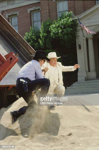 Sheriff Roscoe P Coltrane played by James Best gives Jefferson Davis 'Boss' Hogg played by Sorrell Booke a hand after a truckload of sand spills in...