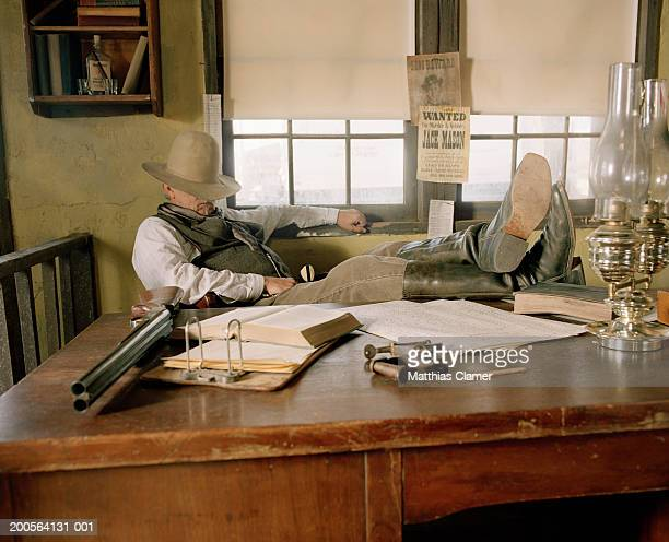 sheriff sleeping at desk in office - sheriff stock pictures, royalty-free photos & images