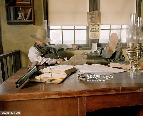 sheriff sleeping at desk in office - 保安官 ストックフォトと画像