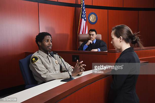 sheriff testifies in courtroom - witness stock pictures, royalty-free photos & images