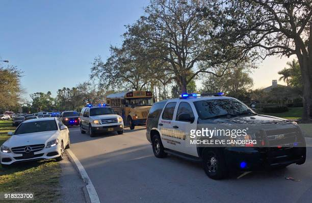 Sheriff vehicles are seen at Marjory Stoneman Douglas High School in Parkland Florida a city about 50 miles north of Miami on February 14 2018...