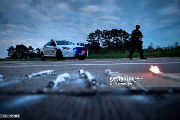 Sheriff walks near a roadblock after a chemical plant operated by the Arkema Group had an explosion during the aftermath of Hurricane Harvey August...