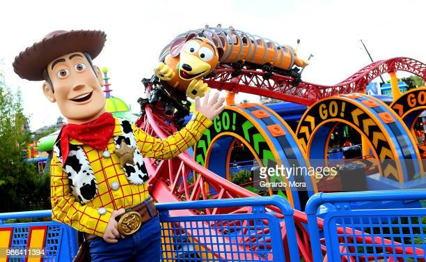 Sheriff Woody poses in front of the Slinky Dog Dash ride during a preview of The Toy Story Land at Disney's Hollywood Studios on June 28 2018 in...