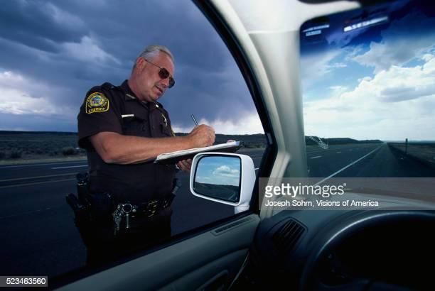 sheriff writing speeding ticket - sheriff stock pictures, royalty-free photos & images