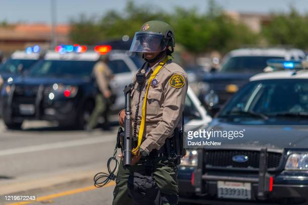 Sheriffs block marchers from continuing down E Palmdale Boulevard after a demonstration on June 13 2020 in Palmdale California The marchers were...