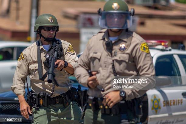 Sheriffs block marchers from continuing down E. Palmdale Boulevard after a demonstration on June 13, 2020 in Palmdale, California. The marchers were...