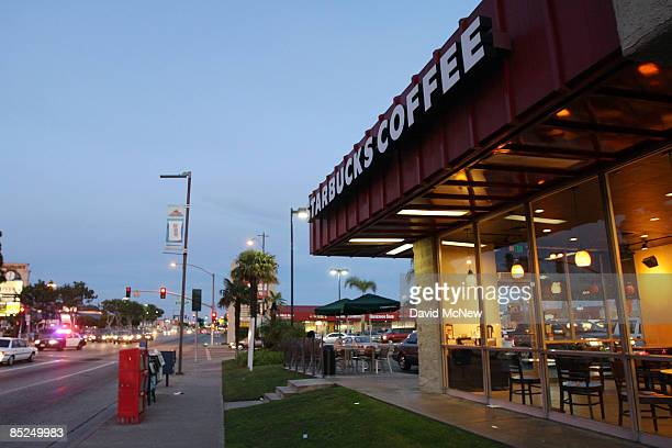 A sheriff's car speeds past a Starbucks coffee store March 3 2009 in Compton California The city that became known as the birthplace of gangsta rap...