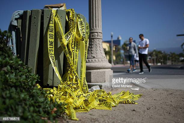 Sheriffs crime scene tape fills a trash container near a shooting site on Del Playa Drive May 25, 2014 in Isla Vista, California. According to...