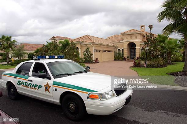 Sheriff's Department patrol car drives past the home of disgraced NBA referee Tim Donaghy in Bradenton, Fla. Donaghy is alleged to have placed...