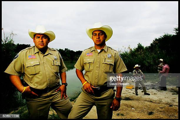 Sheriff's deputies Abel Hinojosa and Morcos Pampa by the Rio Grande which marks the border with Mexico where they were threatened by a drug cartel...