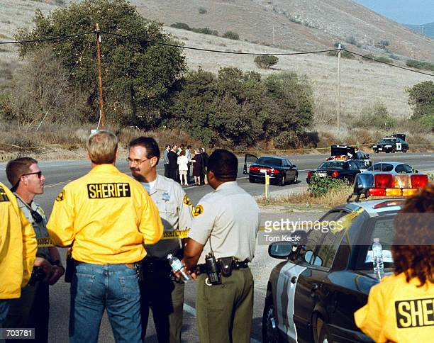 Sheriffs deputies and homicide investigators discuss the finding of a body of a girl February 27 2002 near El Cajon CA San Diego County District...