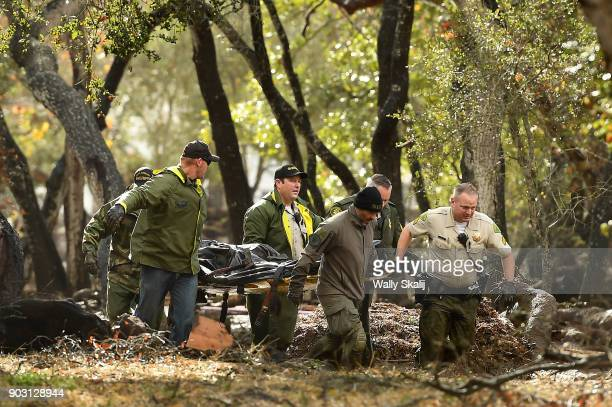 Sheriffs deputies carry a body from the debris near Hot Springs Road in Montecito after a major storm hit the burn area Tuesday January 9 2018 in...