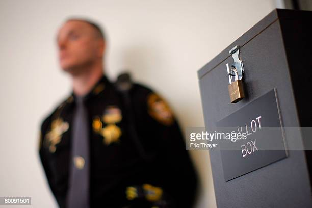 Sheriff's deputy keeps watch over a ballot box at the Franklin County Election Board at the Franklin County Memorial Building March 3 2008 in...