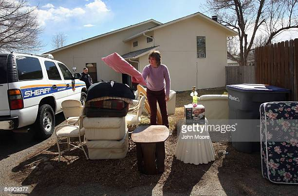 Sheriff's deputy Rick Ferguson supervises as a landlord removes furniture from a home after the tenants were evicted February 18 2009 in Lafayette...