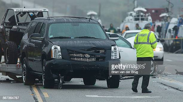 Sheriff's investigators work an accident scene on PCH where one person was killed and at least seven other people were injured in a fourvehicle crash...