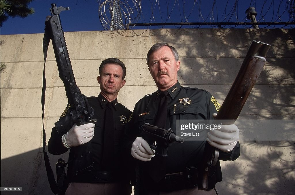 Sheriffs (L-R) John Dunaway & John Stone) showing 3 weapons used by Columbine High School student gunmen Eric Harris & Dylan Klebold in their April assault on school, massacre ending in their suicide.