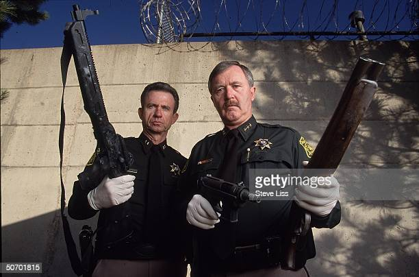 Sheriffs John Dunaway John Stone showing 3 weapons used by Columbine High School student gunmen Eric Harris Dylan Klebold in their April assault on...