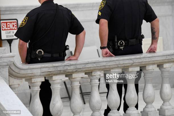Sheriffs lean against the railing outside of the courtroom at the Montgomery County Courthouse on the second day of sentencing in Bill Cosby's sexual...