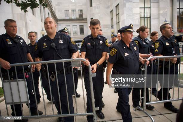 Sheriffs move a barricade as Bill Cosby departs in his SUV outside he Montgomery County Courthouse on the first day of sentencing in his sexual...