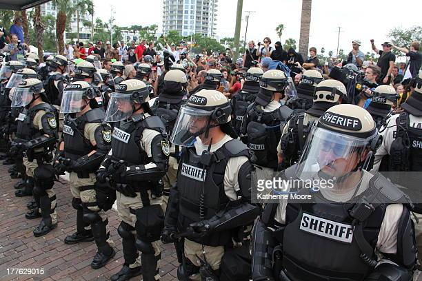 Sheriffs separate Westboro Church protesters from counter-protesters at a rally during the Republican National Convention.