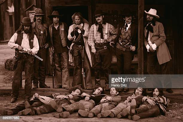 Sheriffs stand above captured and hogtied Eagles members during the Desperado album photo shoot The dead outlaws are Jackson Browne Bernie Leadon...