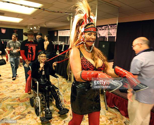 Sherifox pretends to be a horse as she pulls Carina Cruz in her wheelchair during the 8th annual DomCon LA convention on May 20 2011 in Los Angeles...