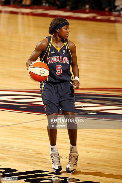 Sherill Baker of the Indiana Fever moves the ball against the Houston Comets during the game at Reliant Arena on June 28, 2008 in Houston, Texas. The...