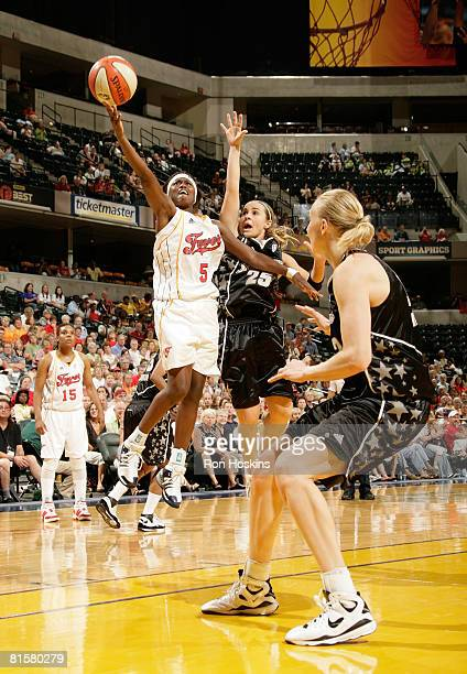 Sherill Baker of the Indiana Fever shoots over Becky Hammon of the San Antonio Silver Stars at Conseco Fieldhouse on June 15 2008 in Indianapolis...