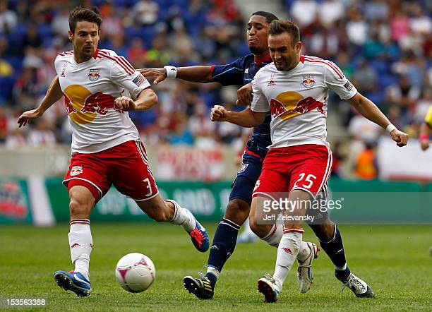 Sherjill Macdonald of Chicago Fire chases Heath Pearce and Brandon Barklage of New York Red Bulls during their match at Red Bull Arena on October 6,...